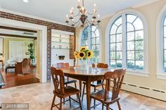 Thinking about giving your dining room a make over. We are head over heels for this gorgeous exposed brick in this sunny dining room.