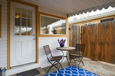 Bistro table and chairs and a bright run on the back patio create a great space to enjoy coffee...or wine!