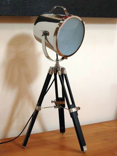 This stunning black wooden tripod chrome spotlight table lamp is a real eye-catcher It measures H75xW32xD32cm and is a unique striking combination of
