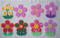 hama/perler bead or cross stitch designs - jewelry, charms, keyrings, cards... could back with fabric - try retro 70s motifs?