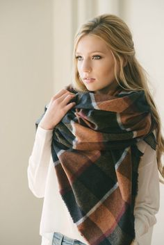 Woven in a traditional-looking plaid, this gorgeous wool infinity scarf is the perfect accent to a neutral fall outfit. Navy hues mix with grey and a