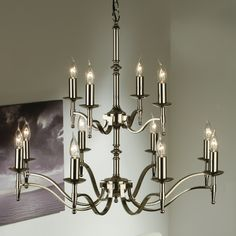 Classic 12 chandelier in a stunning polished nickel finish.   Handmade in England to the highest quality.