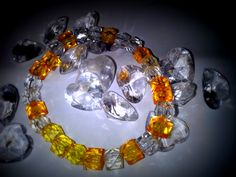 white and orange colour bracelet Made by Einie
