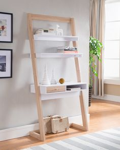 With an intriguing ladder design, this desk will surely be an eye catcher. With a total of three white shelves supported by a weathered white frame, this desk proves to be both beautiful and versatile White Shelves, Built In Shelves, Desk Shelves, Open Shelves, Stair Shelves, Ladder Shelves, Wall Shelving, Shelving Ideas, Floating Shelves