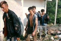 Muslim refugees attend to Serb forces in Srebrenica, Yugoslavia on July 14, 1995.