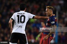 Valencia's midfielder Dani Parejo pushes Barcelona's Brazilian forward Neymar during the Spanish league football match FC Barcelona vs Valencia CF at...