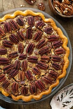 Homemade pecan pie is a must-have dessert for the holidays! Slices of sweet and gooey filling with crunchy nuts in a flaky pie crust. #pecanpie #pie #dessert #thanksgivingpie