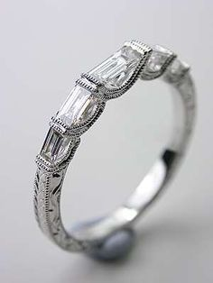 Diamond Wedding Rings Wedding Ring with Baguette Cut Diamonds, - Like it's matching engagement ring, this vintage style wedding band is draped in festive streamers of white gold and baguette cut diamonds. Baguette Diamond Wedding Band, White Gold Wedding Bands, Wedding Rings Vintage, Wedding Jewelry, Gold Bands, Unusual Wedding Rings, Antique Wedding Bands, Purple Wedding, Lace Wedding