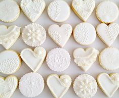 Vintage inspired cookies decorated in hues of cream and pearl, with a touch of gold made for a wedding anniversary celebration. Hand piped lace, embossed vintage patterns dusted with lustre …