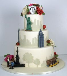 An NYC theme wedding cake for a couple who got engaged in New York's Central Park. Featuring Empire State Building, Statue of Liberty, Grand Central Terminal Station & the Chrysler Building | W Cake Decorating