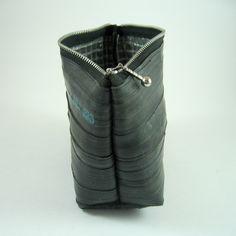 Recycled bike inner tube cosmetic bag with  print.. via Etsy.