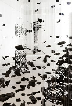 """Curated*Spark: Suspended Charcoal Artworks by Seon Ghi Bahk: Seoul-based artist Seon Ghi Bahk created dreamy doric """"columns"""" made of natural pieces of charcoal suspended on invisible nylon string. Recently on display at the Zadok Museum in Miami, these pixelated masterpieces, entitled Fiction of the Fabricated Image, seem to mysteriously dissolve into thin air."""