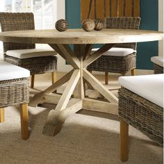 A round dining table made of salvaged wood is a solid choice for a breakfast nook or dining room.   $1,700