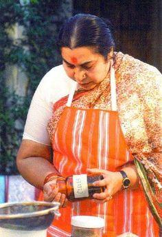 Shri Mataji in kitchen with condimentes