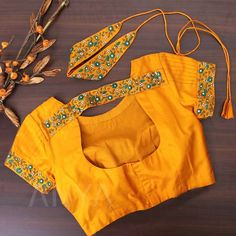 Bright vibrant and beautifully designed. This customized blouse is made with a pot neck and waist belt. Blouse Back Neck Designs, Kids Blouse Designs, Hand Work Blouse Design, Simple Blouse Designs, Stylish Blouse Design, Fancy Blouse Designs, Bridal Blouse Designs, Sari Blouse Designs, Choli Designs