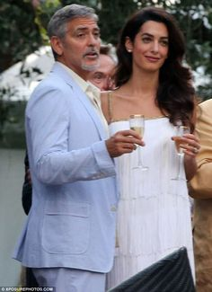 Cheers to that: George and Amal Clooney have taken their twins to Lake Como for the summer...