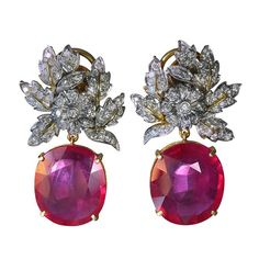 A Pair of Ruby and Diamond Earrings | From a unique collection of vintage chandelier earrings at https://www.1stdibs.com/jewelry/earrings/chandelier-earrings/