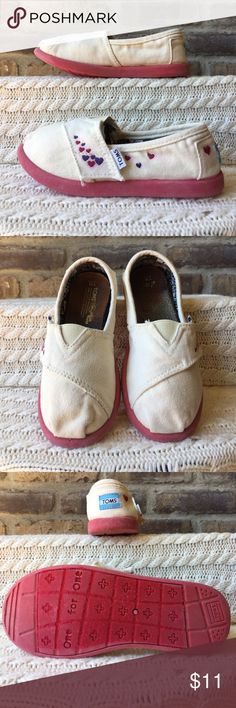 TOMS Girls size 11 cream colored TOMS. Notice in pictures bleeding around the hearts also could use new inserts. They are priced to sell. TOMS Shoes