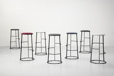 Barbry Stools designed by French designer Aurélien Barbry. The Barbry Collection consists of a barstool and three side tables of various heights. Steel and wood is shaped into a graphical, yet functional new series of furniture.