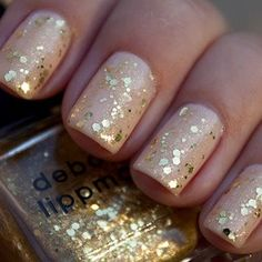 Sparkles don't have to be full-on. The number of coats you apply determines how sparkly your nails will get. Slick on one layer for a subtle look. At L&G Hair Studio where your Beauty is our Business 405-670-5336.