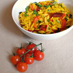 Ingredients: 1 cup (150g) dried orzo pasta 1 tsp ground turmeric 1/2 red bell pepper 1/2 cup (50g) sun dried or sun kissed tomatoes, cut into bite-sized pieces 2 tablespoons chopped chives 2 tablespoons fresh basil leaves, torn For the dressing: 1 large clove of garlic 1/2 tsp salt 1 tablespoon lemon juice 1 tablespoon balsamic vinegar 1 tablespoon olive oil 2 tsp tomato puree ground black pepper to taste Optional For a smokey accent, add 1/2 tsp of smoked paprika to the dressing