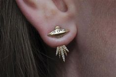 About The most precious exploration of a flying saucer with a glittering light beam. This baby UFO can't help but abduct Earthlings, they're all so cute! Description Made by hand in our Montreal studio Featuring a tiny UFO stud earring with three 1.0mm diamonds along with an ear jacket abduction light beam containing 1
