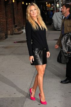 With black blouse and leather mini skirt