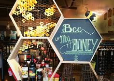 Merchandise Display & Retail Decor | Product display showcasing select honey products for Valentine's Day inspired by trendy geometric shapes