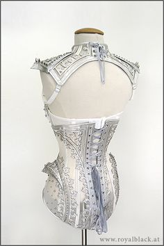 open back - dragon spine in mail down, cut on lower corset piece with a dip to show more spine.