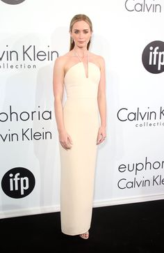 Blunt went streamlined in this cream-hued column gown by Calvin Klein.   - MarieClaire.com