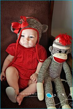 How adorable is this sock monkey hat?!?! and her cute little red outfit I love it!