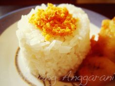 Open onigiri, Javanese style. Steamed sticky rice, spicy coconut powder and banana fritters