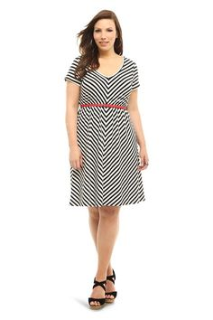Black mitered stripes create bold trend-right contrast across this white short sleeve knit dress. We've included a skinny red belt for an eye-catching pop of color.