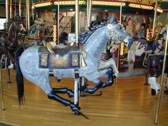 A Carousel for Missoula Dispatch - Dispatch is a Pony Express horse complete with a bugle and locking mail bags.