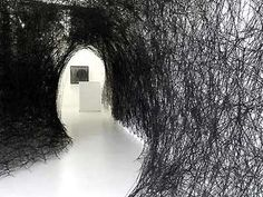 Japanese-born artist Chiharu Shiota wraps objects from floor to ceiling in miles of black wool