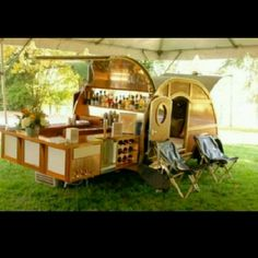 I so love this. A bar on wheels, that comes with a bed......genius