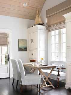 love the roman shade, bench seating, rustic table, builtin cabinets...and oh those windows. LOVE, LOVE!