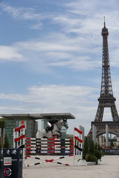 French actor Guillaume #Canet and his horse Jumping Star Callius on top of a 1m80 fence, during the City of Paris Record class that occured the very first day of the #Longines Global Champions Tour Paris Eiffel Jumping presented by #Gucci