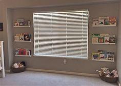 Bookshelves framed around the window. And stuffed animal baskets.