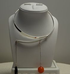 Halsring silver, with two pendants in coral and agate; design Torun Bulow Hube