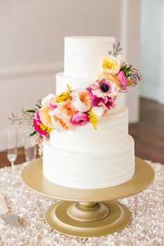 Four tier textured cascading colorful rose wedding cake: http://www.stylemepretty.com/little-black-book-blog/2016/12/19/colorful-charleston-spring-wedding/ Photography: Dana Cubbage - http://danacubbageweddings.com/