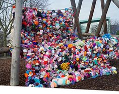 Pompom tapestry pictured outside in a park