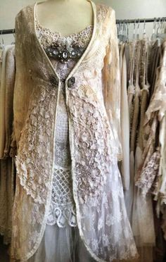 Vintage long embroidered sweater over modern lacy dress. Lovely.
