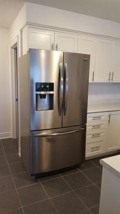 Fridgidaire Gallery  counter depth French door fridge smudge proof  Soho white kitchen with stainless steel appliances, grey floors