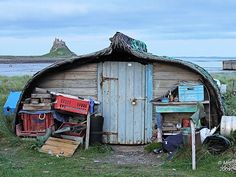 Lindisfarne - boat sheds and castle by Maria-H, via Flickr