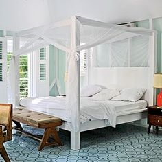 Soft green walls and mosaic tile in shades of blue contribute to the ocean feel of this bedroom. To up the wow factor, limit a patterned tile to one or two rooms and keep other patterns in the space to a bare minimum.