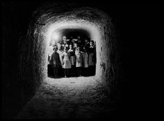 Such a striking image -   SPAIN. The Spanish Civil War. The Republican side. - SPAIN. Island of Minorca. Children take refuge in underground shelters to escape the bombings. Minorca is the only island that remains loyal to the Republic. Located directly across the Catalan coast and close to the Franquist island of Majorca, its main town found itself in the path of the Italian Fascist army. 1938.