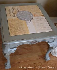 Repurposed old wood coffee table. Top is decoupaged print from thegraphicsfairy.com website onto ugly smoked glass inset. Clever! Could possibly do this with glass top vanity.