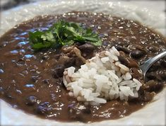 Best Ever Black Bean Soup 2 cans of seasoned black beans (drained, not rinsed) 1 can chicken broth 1 1/2 cups water 2 Tbsp olive oil 1 cup chopped onion 2 cloves of garlic minced 2 tsp chili powder 1/4 tsp cumin White Rice  ***sub chicken broth with veggie broth