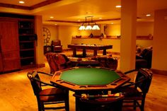 Basement game room... The thing that I love from this design idea is that beautiful poker table.